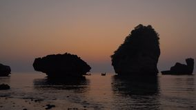 Twilight Timelapse over the Rocks in the Sea at Thailand, Phi-phi island, Nui Bay Lagoon. 4k UHD stock video footage