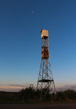 Twilight Tower. Lookout Tower with the moon too Stock Photos