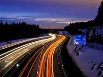 Twilight traffic. Evening traffic on norwegian freeway Stock Images