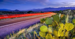 Twilight Trails. Motion Blurred light trails stretch far into the distance of this Arizona Highway Stock Image