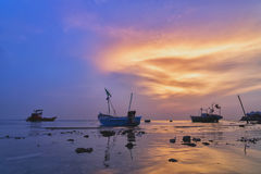 Twilight and vessels at the sea. Background with beautiful twilight on the sky and show every evening after out fishing vessels, fishermen will be parked on the royalty free stock image