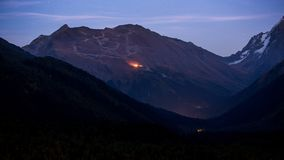 Twilight view of Mussa-Achitara mountain and ski slopes in Dombay Royalty Free Stock Photo