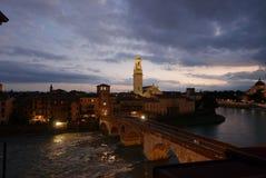 Adige river and roman bridge in Verona. Twilight view over river and ponte pietra stock image