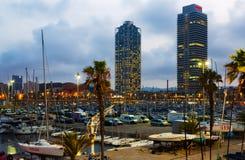 Twilight view of Port Olimpic. BARCELONA, SPAIN - AUGUST 7, 2015:  Twilight view of Port Olimpic Royalty Free Stock Image