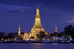 Night view of Famous Thai temple. Twilight view Pra Prang of Wat Arun,  across Chao Phraya River during sunset, Bangkok, Thailand Stock Photo