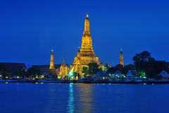 Wat Arun across Chao Phraya River during twilight Royalty Free Stock Photos