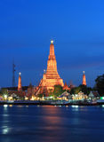 Twilight view of Wat Arun across Chao Phraya River during sunset in Bangkok, Thailand Royalty Free Stock Photography