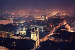 Twilight in Lviv. Twilight view of western european city Lviv, architecture background in violet colors stock photo