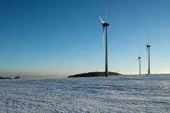 Twilight of wind power in the Ore Mountains. Wind power plants in the winter in the Ore Mountains Royalty Free Stock Image