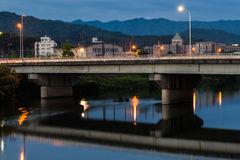 Twilight in Yamaguchi City, Japan. View from the riverside with colorful lights reflect on the water Royalty Free Stock Photos