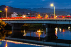 Twilight in Yamaguchi City, Japan. View from the riverside with colorful lights reflect on the water Stock Image