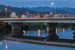 Twilight in Yamaguchi City, Japan. View from the riverside with colorful lights reflect on the water Royalty Free Stock Image