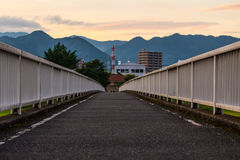 Twilight in Yamaguchi City, Japan. Views from the bridge, there are many mountain far away with the colorful sky Stock Photography