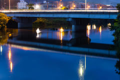 Twilight in Yamaguchi City. View from the riverside during the twilight. Beautiful lights reflect on the water Stock Photos