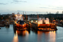 Twilight in the yard. View of the ships repaired in the docks of Gdansk Royalty Free Stock Images