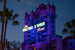 The Twilight zone Tower of Terror and palm trees on blue sky background in Hollywood Studios at Walt Disney World  7. Orlando, Florida. Jun 06, 2019. The stock image