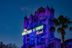 .The Twilight zone Tower of Terror and palm trees on blue sky background in Hollywood Studios at Walt Disney World  4. Orlando, Florida. Jun 06, 2019. The royalty free stock image