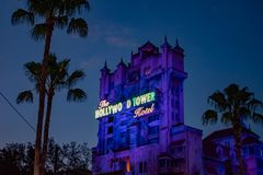The Twilight zone Tower of Terror and palm trees on blue sky background in Hollywood Studios at Walt Disney World  3. Orlando, Florida. Jun 06, 2019. The royalty free stock photos