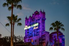 The Twilight zone Tower of Terror and palm trees on blue sky background in Hollywood Studios at Walt Disney World  6. Orlando, Florida. Jun 06, 2019.The Twilight royalty free stock images