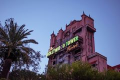The Twilight zone Tower of Terror and palm trees on sunset background in Hollywood Studios at Walt Disney World  1. Orlando, Florida. March 19, 2019. The stock photo