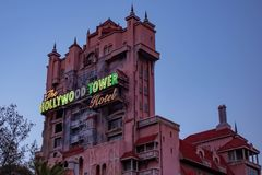 .The Twilight zone Tower of Terror and palm trees on sunset background in Hollywood Studios at Walt Disney World  3. Orlando, Florida. March 19, 2019.The stock photo