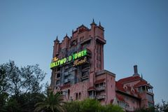 The Twilight zone Tower of Terror and palm trees on sunset background in Hollywood Studios at Walt Disney World  2. Orlando, Florida. March 19, 2019.The Twilight stock images