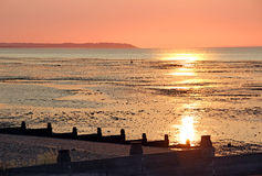 Twilights return. Photo of a beautiful summer sunset scene over the bay of whitstable in kent Stock Image