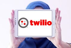 Twilio communications company. Logo of Twilio company on samsung tablet holded by arab muslim woman. Twilio is a cloud communications platform as a service PaaS Stock Photos