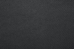 Twill weave fabric pattern texture background closeup. Black twill weave fabric pattern texture background closeup Stock Image