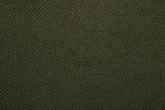 Twill weave fabric pattern texture background closeup. Green twill weave fabric pattern texture background closeup Royalty Free Stock Photography