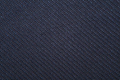 Twill weave fabric pattern texture background closeup. Navy twill weave fabric pattern texture background closeup Royalty Free Stock Photo