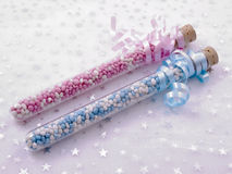 It is a twin. Two glass-tubes filled with sweets for birth decoration Royalty Free Stock Photo