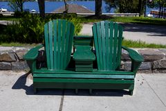 Twin Adirondack Chair bench on the sidewalk Stock Photography