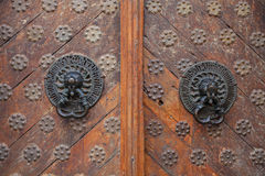 Twin antique handles old style on wooden doors Royalty Free Stock Images
