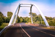 Twin Arch Bridge which replaced the old Bailey Bridge in 2010 in UK. Twin Arch Bridge which replaced the old Bailey Bridge in 2010 in Ayrshire Scotland UK royalty free stock photography