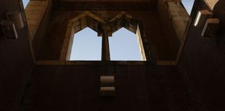 Twin Arched Windows and The Sky Beyond Stock Photos
