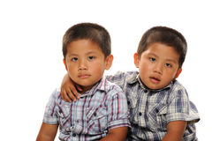 Twin asian boys. Cuddle and look cute stock photo