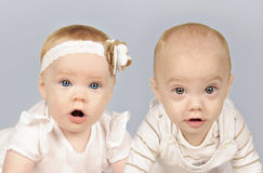 Twin baby brother and sister Royalty Free Stock Image