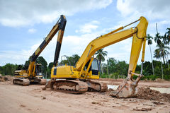 Twin backhoes Stock Images