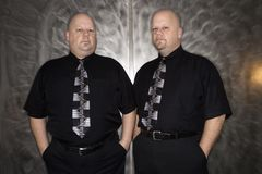 Twin bald men. Royalty Free Stock Photos