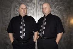 Twin bald men. royalty free stock photos