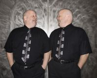 Twin bald men laughing. royalty free stock images