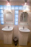 Twin basins. Bathroom, two basins, mirrors, lamps Royalty Free Stock Photos