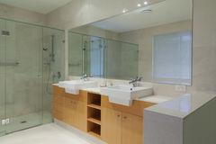 Twin bathroom. Modern, stylish twin bathroom with double sinks and shower Royalty Free Stock Image
