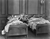 TWIN BEDS. (All persons depicted are no longer living and no estate exists. Supplier grants that there will be no model release issues Royalty Free Stock Photo