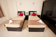 Twin beds in a bedroom Stock Photos