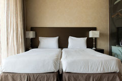 Twin beds in hotel bedroom Royalty Free Stock Image