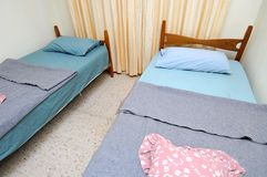 Twin beds in simple motel room Royalty Free Stock Photography