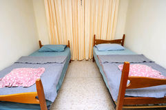 Twin beds in simple motel room Royalty Free Stock Photos