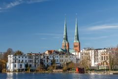 Twin bell-towers of the medieval Gothic church in Lubeck stock photo